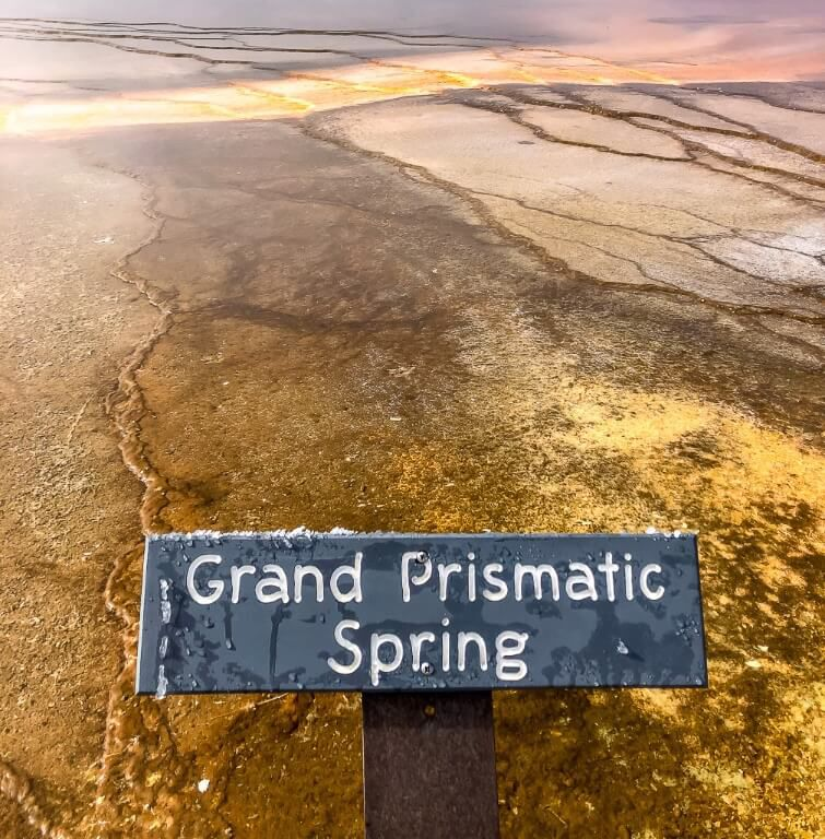 Grand Prismatic Spring sign with colorful hot spring behind