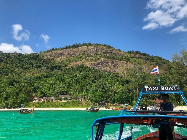 Koh Adang viewpoint seen from the taxi long tail boat on the sea