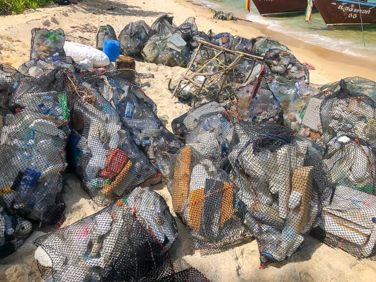 Trash hero project cleaning up rubbish from Thai islands dozens of filled bags