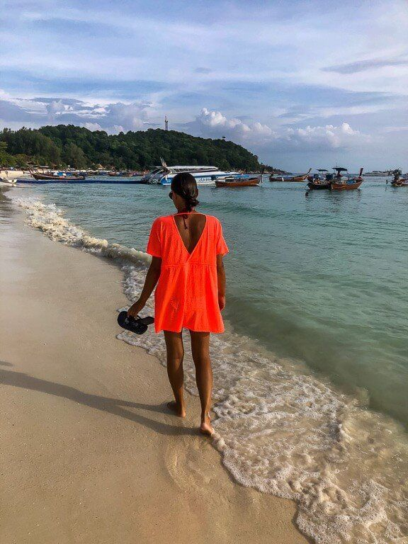 Kristen walking along the shores of the Andaman sea and Pattaya Beach in Koh Lipe Thailand