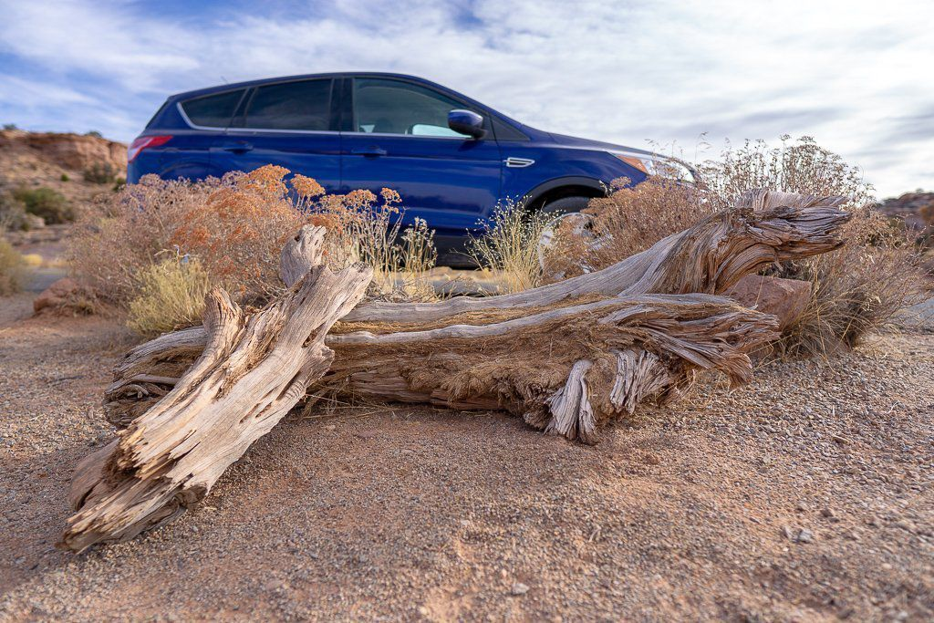 Mark and Kristens car driving from moab to arches and canyonlands in one day Utah road trip