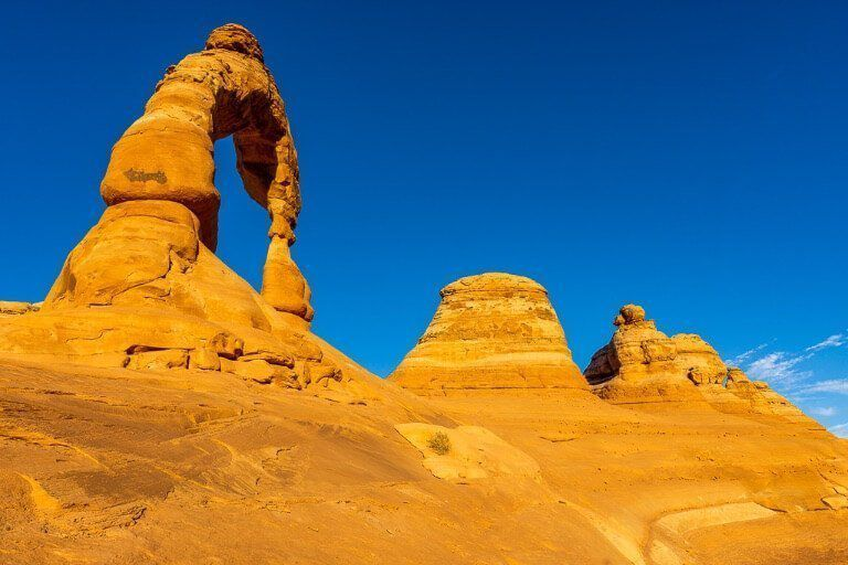 Behind Delicate Arch different perspective with bright blue sky