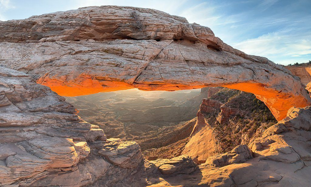 Mesa Arch glowing red just after sunrise in canyonlands national park Utah