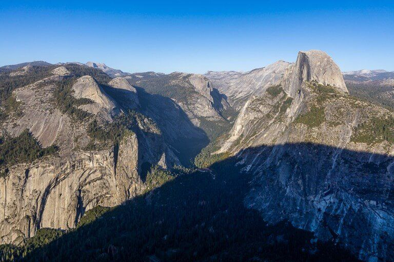 Half Dome almost covered by a huge shadow in late afternoon
