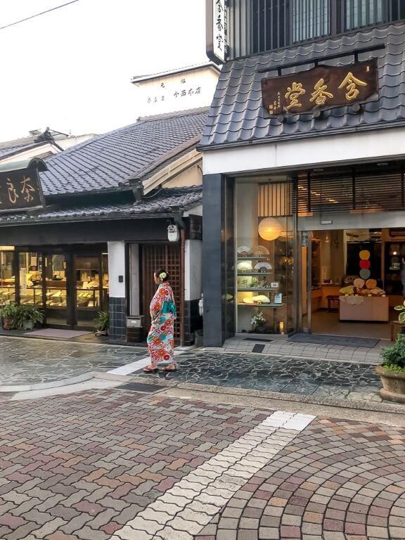 Woman in Kimono Japanese city walking around shopping district