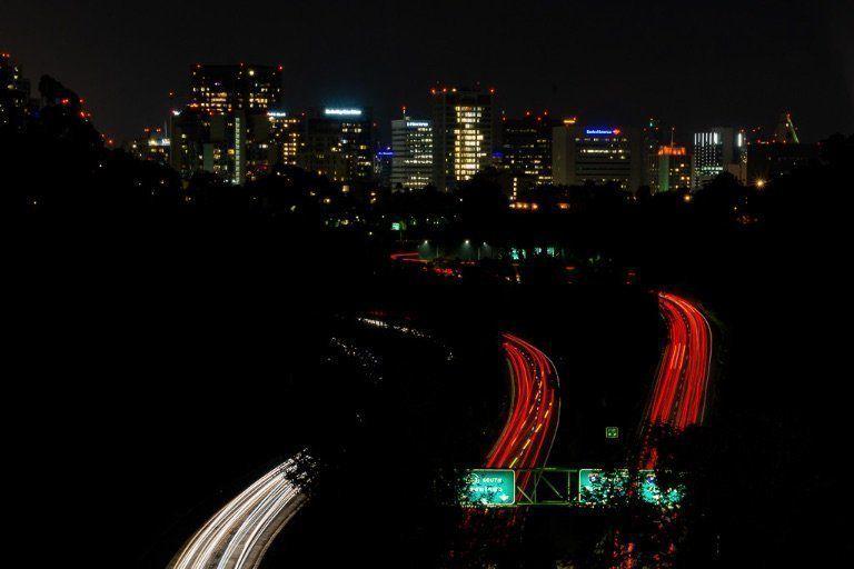 Cabrillo Bridge Balboa park San Diego view of city and cars
