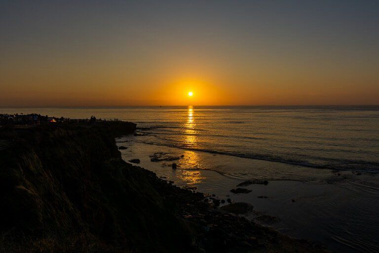 Stunning sunset in San Diego sunset cliffs neighborhood sun reflecting across the Pacific Ocean Best things to do in San Diego first time visitor vacation itinerary
