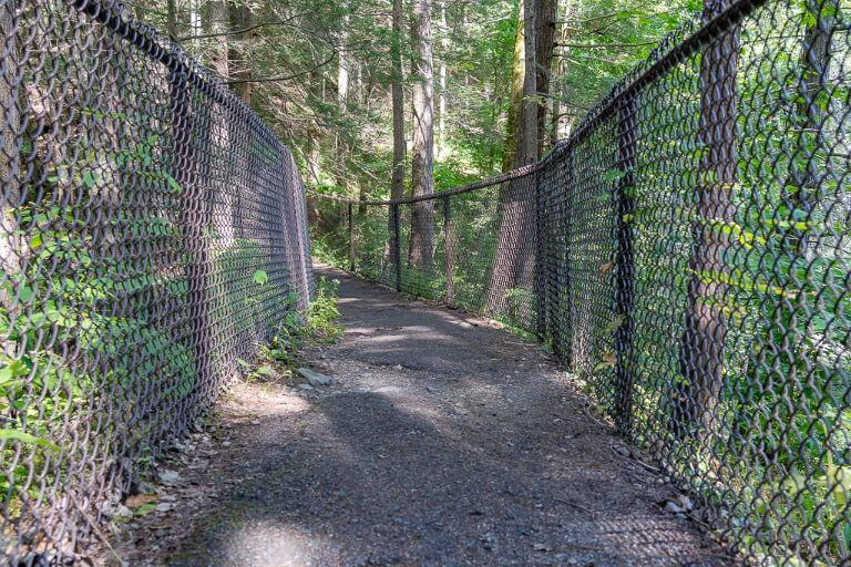 Pathway with fenced gates up at each side of the trail
