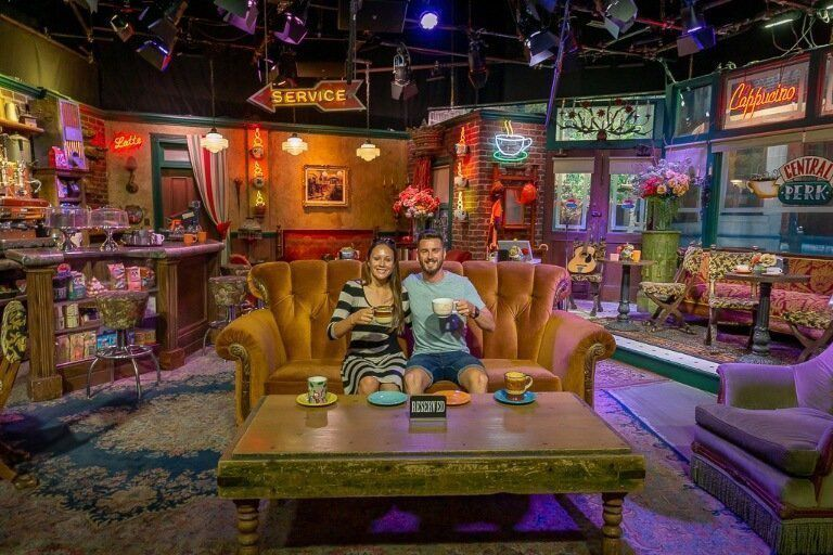 Mark and Kristen sitting at the famous sofa in central perk from friends tv show