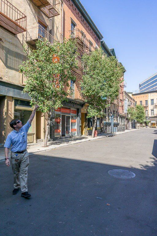 Warner Bros studio tour guide explaining about the backlot set and which movies were filmed there