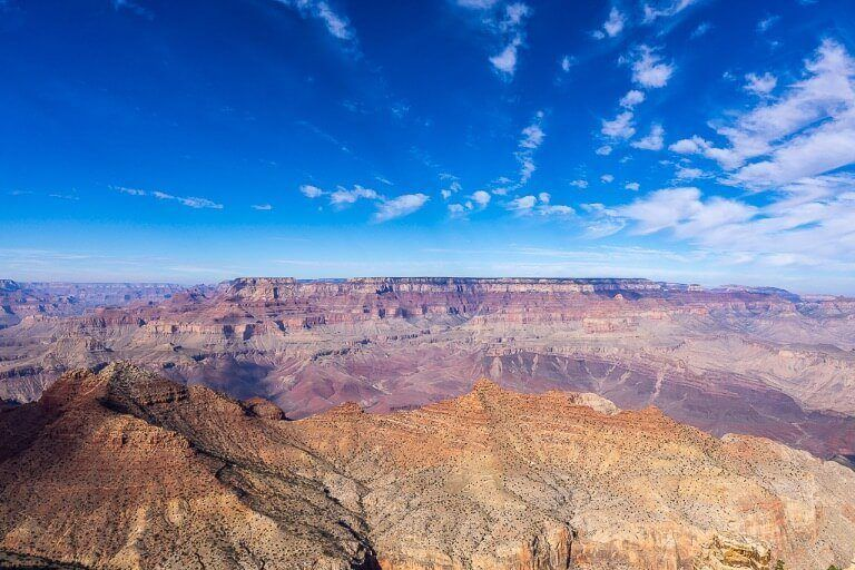 Mesmerizing scenery from Desert View Watchtower Grand Canyon South Rim Best things to do in one day beautiful blue sky contrasting against canyon formations
