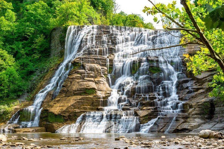 Close up of Ithaca Falls waterfall lightly flowing at the end of Summer