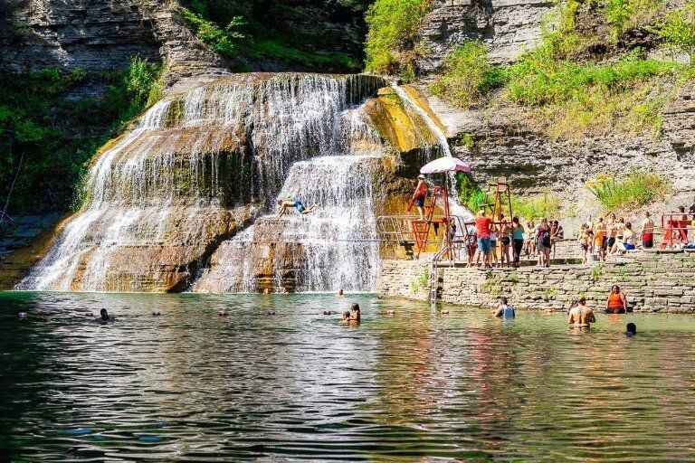 Lower Falls at Robert H Treman State Park near Ithaca New York people jumping in pool from diving board