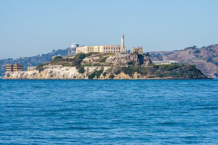 Alcatraz Island from SF bay Pier 33 with telephoto lens the rock looks desolate