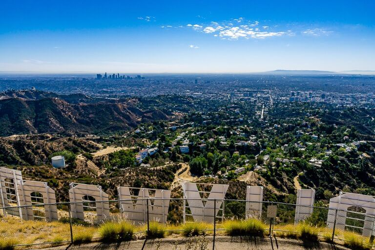 Los Angeles is the biggest of the 3 cities along California Pacific Coast highway 1 from San Francisco to San Diego Hollywood sign from Mt Lee overlooking LA city amazing view
