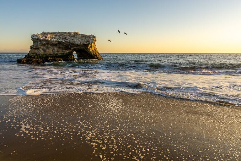 Natural bridges state park near Santa Cruz is the perfect place to watch sunset over California's pacific coast not far from highway 1