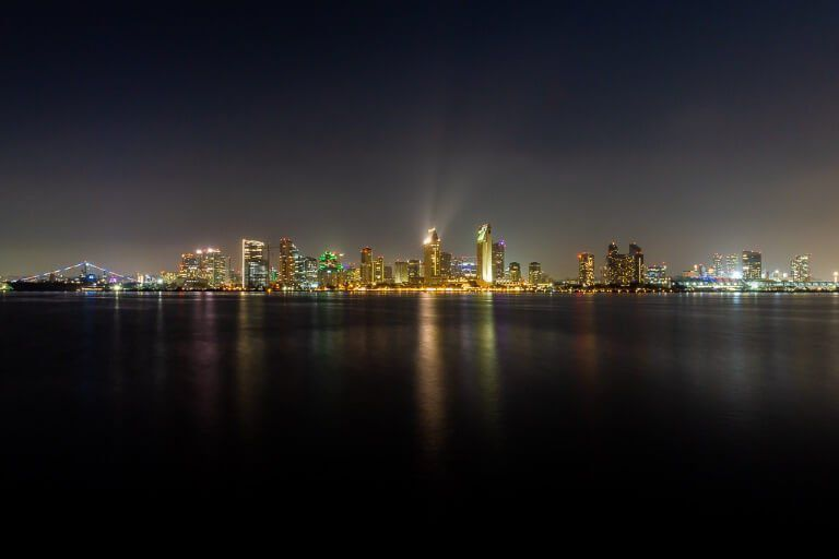 San Diego night skyline from Coronado island looking amazing and still San Diego is the end of California's Pacific Coast Highway and the perfect place to complete the epic road trip from San Francisco