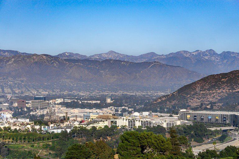 Mulholland Drive in Los Angeles offers elevated views over mountains and city including universal studios