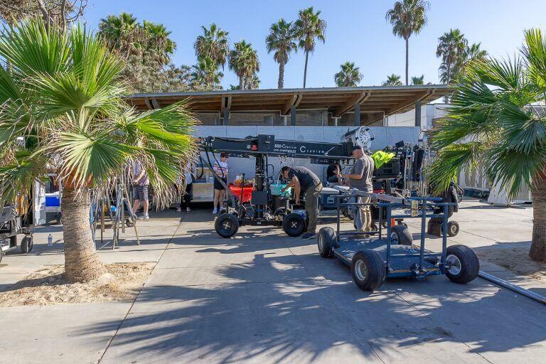 Film crew filming tv show along Venice beach Santa Monica beach walkway