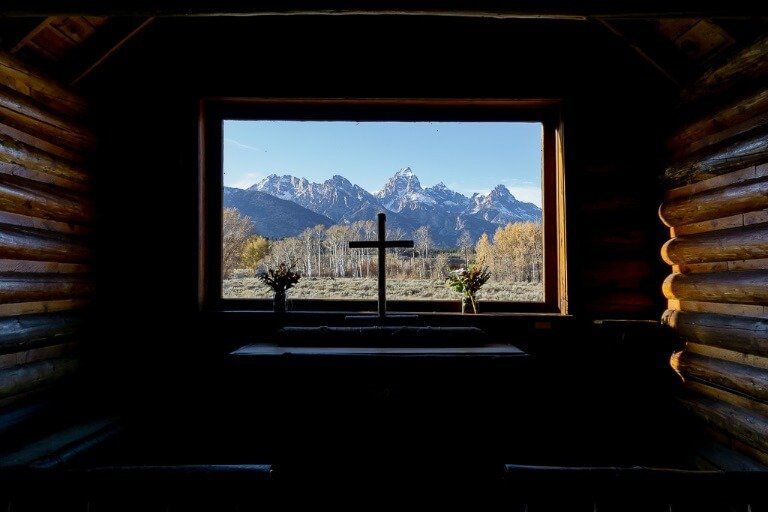 Iconic photograph through window chapel of transfiguration grand teton national park best things to do