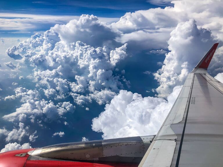 Airplane in dense clouds in Asia