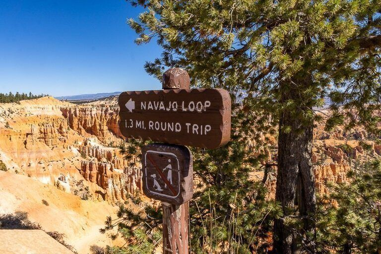 Sign indicating direction to a walk in utah