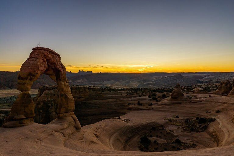 Delicate Arch sunset hike in arches national park utah incredible scenery as far as the horizon