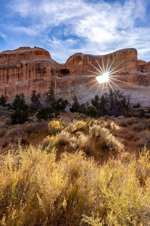 Tunnel Arch along devil's garden trail hike in arches national park with amazing starburst