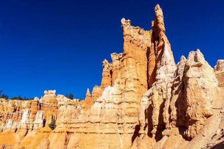Melted wax sandstone hoodoos in utah national park against a deep blue sky
