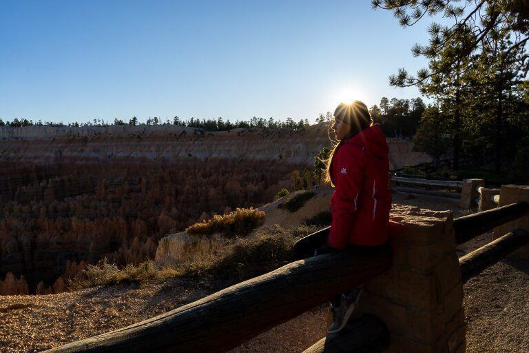 Kristen at sunset with a starburst over her head bryce canyon sunset photography