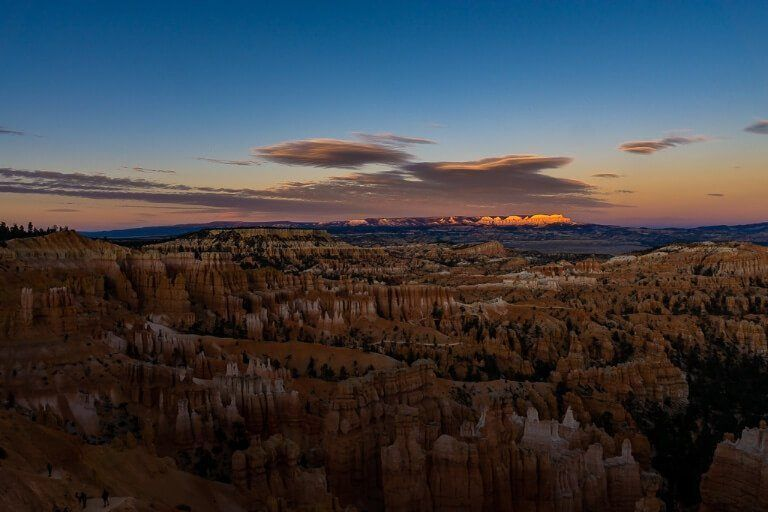 Incredible colors in the sky for Bryce Canyon sunset at sunset point over the impressive hoodoo valley below