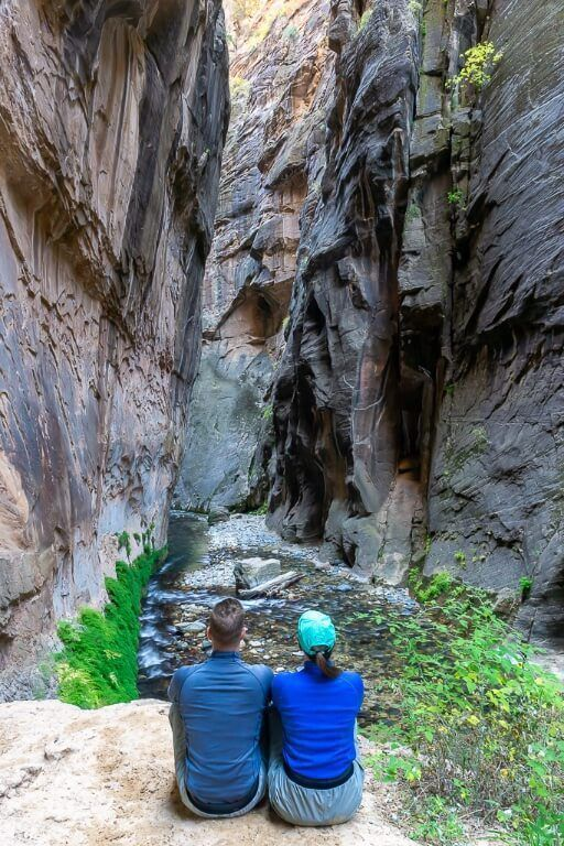 Mark and Kristen where are those morgans sitting on a ledge overlooking zion national park the narrows river slot canyon trail on a bottom up day hike