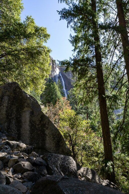 Nevada Fall through trees and rocks on the mist trail yosemite national park