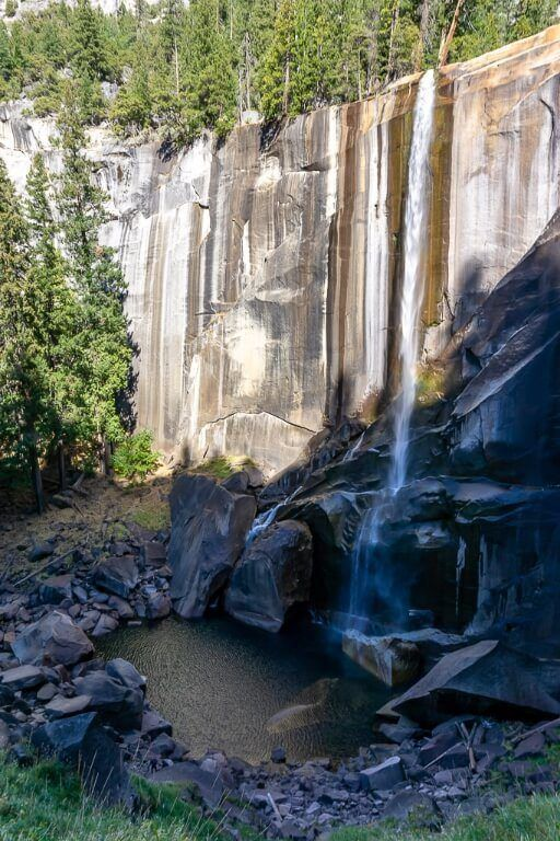 Vernal Fall half in shadow half in light with lunge pool at the base mist trail yosemite national park california
