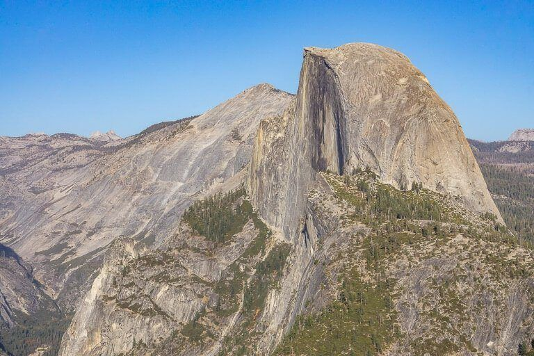 Half Dome photography Yosemite National Park California taken from Glacier Point Zoomed in to show severity of cut in rocks