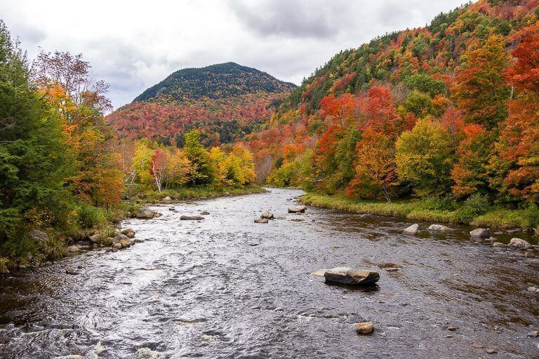 Ausable River running through stunning fall foliage in adirondacks new york