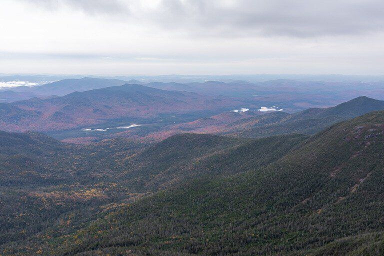 Mount Marcy summit top of the mountain with views over hills as far as the eye can see