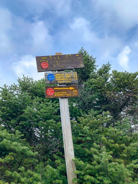 Sign showing the route to Mount Marcy summit in adirondacks