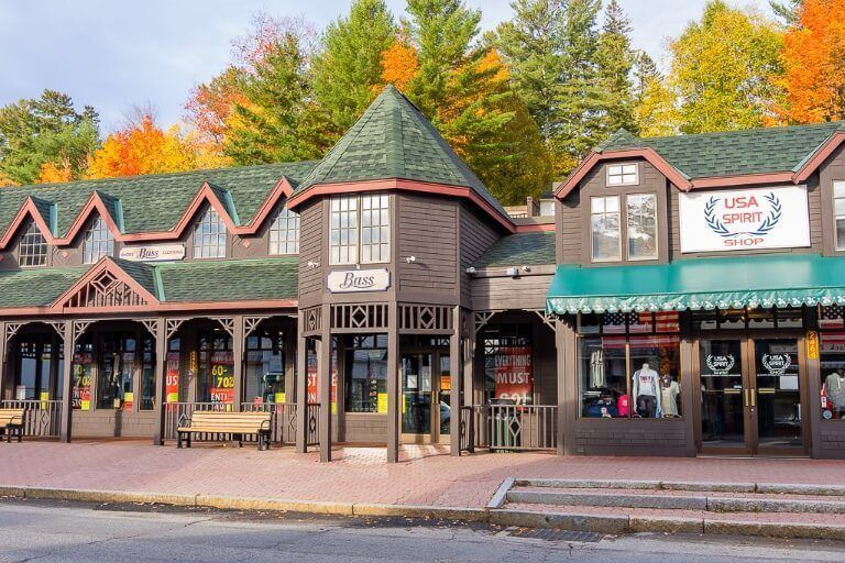Wooden building facades with colorful trees behind in adirondacks ny