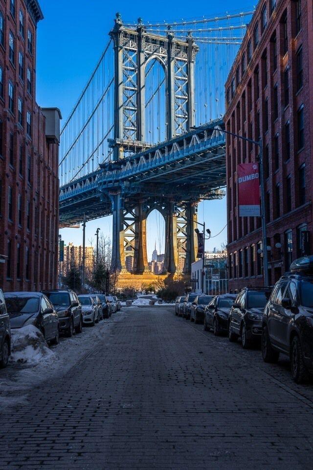 Awesome NYC Photography Manhattan Bridge lighting up at sunrise on washington street in dumbo brooklyn new york city
