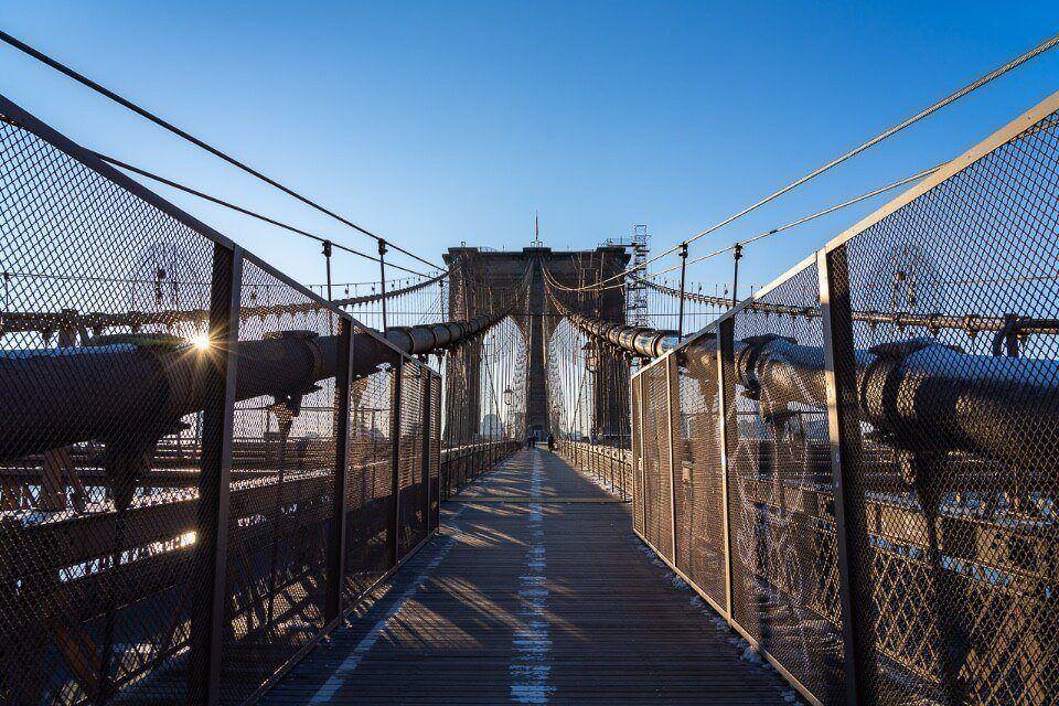 Brown grey steel walking across in new york city