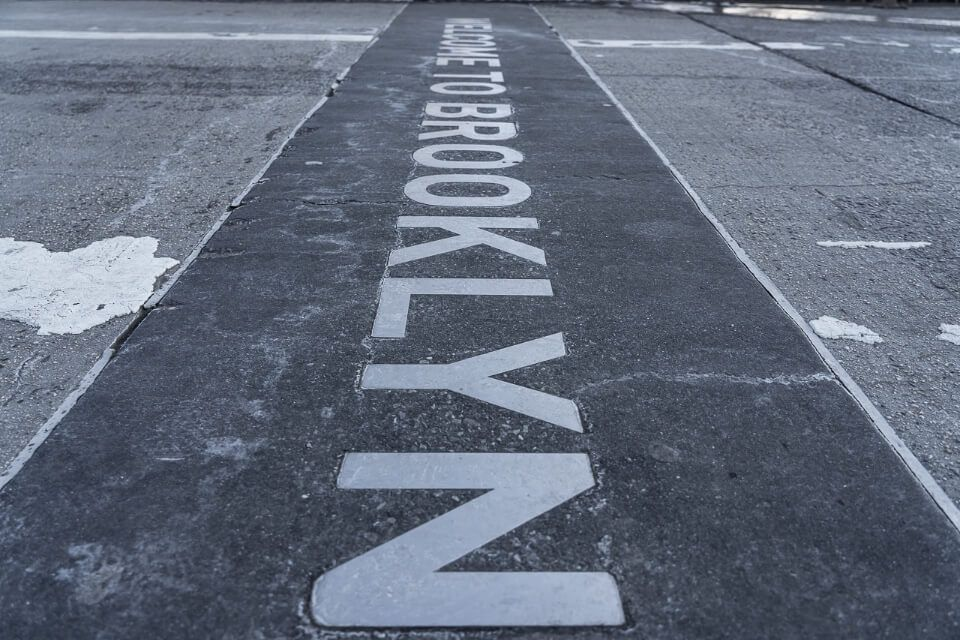 Welcome to Brooklyn sign painted on ground in new york city