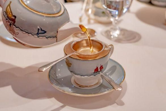 Afternoon tea at the Whitby hotel in manhattan nyc pouring tea from teapot into teacup