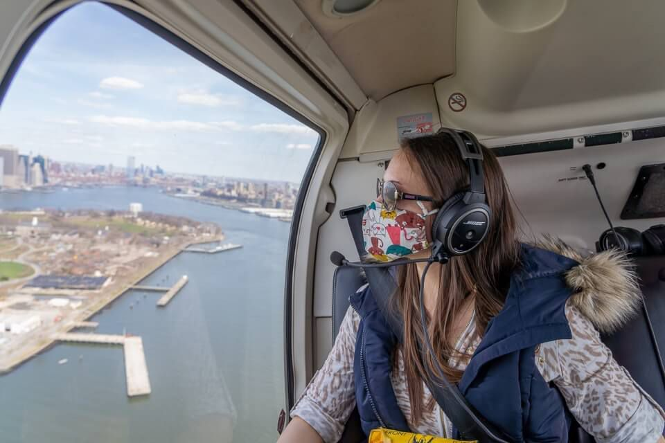 woman in helicopter over new york city
