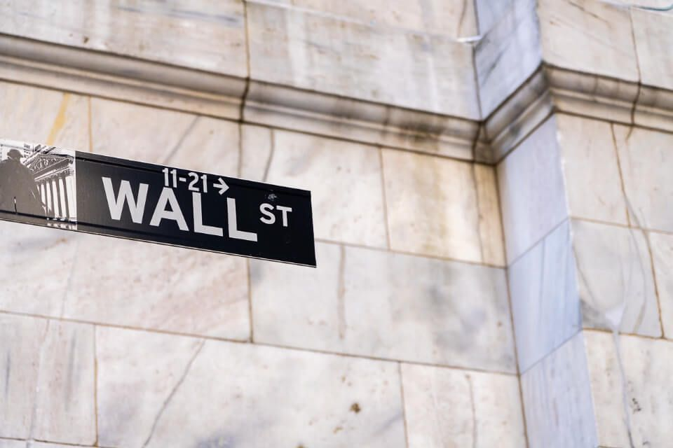 Wall Street Sign against wall backdrop