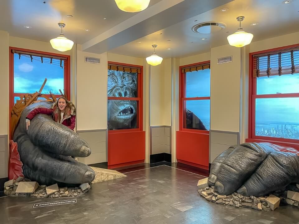 King Kong exhibit with big hands grabbing woman