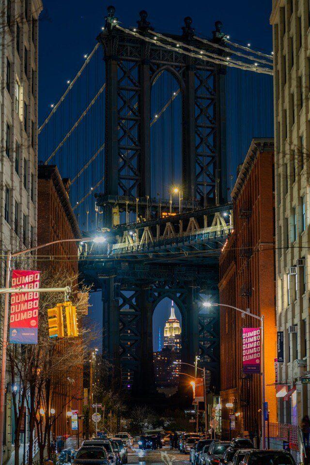 Dumbo Brooklyn Washington street at night manhattan bridge column empire state building
