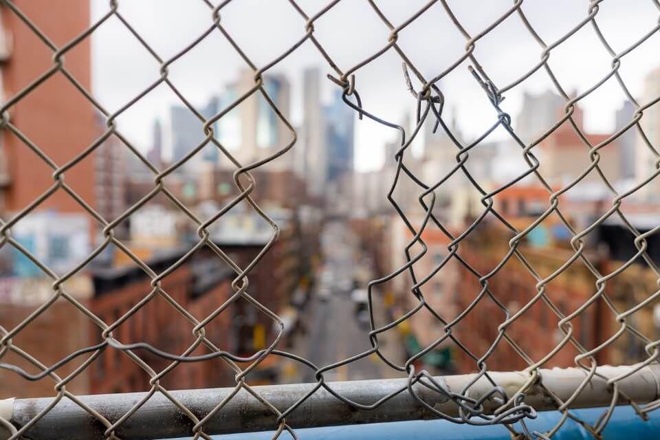 Bokeh hole in fence manhattan bridge photography chinatown nyc