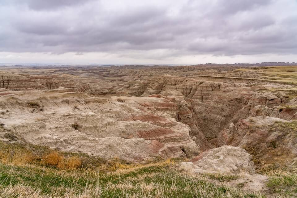 Stunning Badlands National Park landscape in South Dakota with thick clouds in the sky