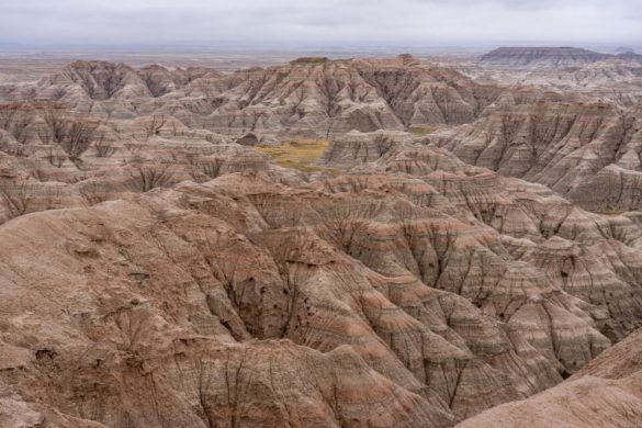 Best hotels near Badlands National Park South Dakota Wall Interior Rapid City Keystone Badlands amazing landscape buttes and spires on a cloudy day